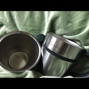2 used but well taken care of Stainless Mugs